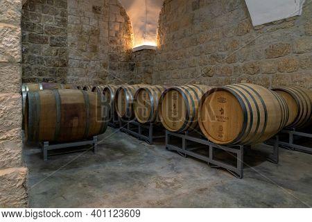 Bethlehem, Israel, December 09, 2020 : Large Wooden Barrels Storing Wine In A Warehouse On The Terri