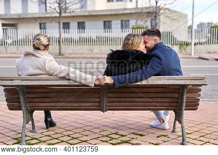 Love Triangle, A Girl Kiss At Her Boyfriend And He Shakes Hands With Another Girl, They Are Sitting