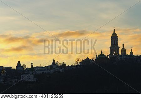 Astonishing Winter View Of Famous Kyiv's Hills Against Cloudy Sky During Sunset. Landscape Of Ancien