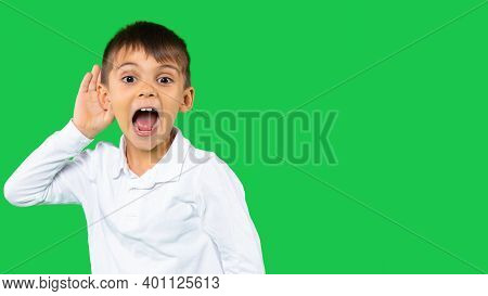 Body Language, Feelings, Senses Concept. Isolated View Of A Amazed Boy In White Shirt Keeping Hand A