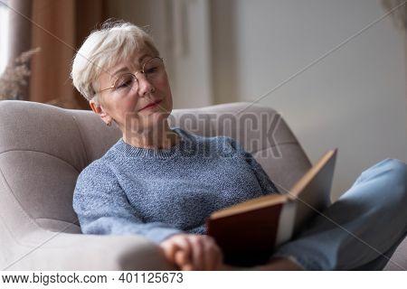 Senior Caucasian Woman At Home Reading Book