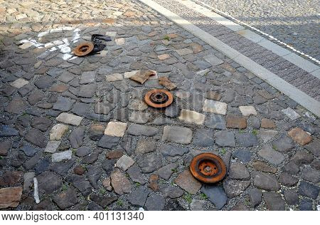 Only Rusty Discs Remained In The Parking Lot After The Car's Brakes Were Repaired. Someone Ruthlessl