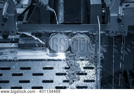 The Automatic Band Saw Machine Cutting The Metal Bar With Coolant Method. The Machine Tool For Indus