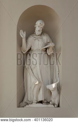 Suderve, Lithuania - April 2, 2017: Statue Of Luke The Evangelist On The External Wall Of The Church