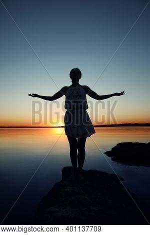 Woman Near River On Sunset. Healing Concept
