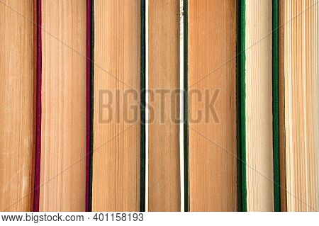 Book Background, A Stack Of Books Pressed Against Each Other. Side View. The Concept Of Education.