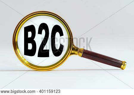 Finance And Economics Concept. Magnifier On A White Background, Inside The Text Is Written - B2c