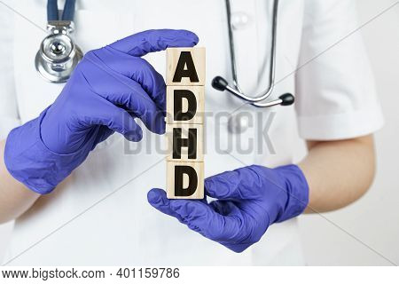 Medicine And Health Concept. The Doctor Holds Cubes In His Hands On Which It Is Written - Adhd. Atte