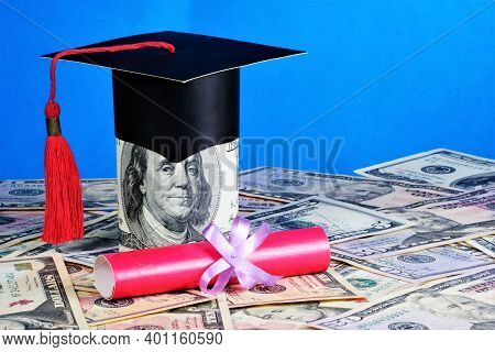 Money For Education. Red Diploma Of The Excellent Student And Academic Cap Of The Student. Funding F
