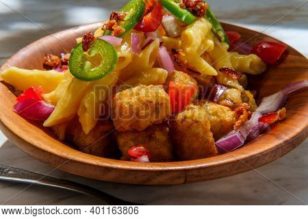 Fancy Gourmet Tater Tot Mac And Cheese Penne Pasta Topped With Diced Red Onion Tomato And Jalapenos