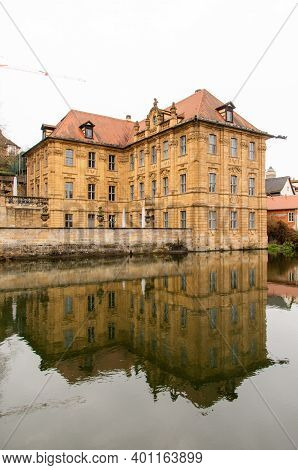 Bamberg, Germany, 20.12.2020. The Famous Villa Concordia Is Reflected In The Water Of The Regnitz. H
