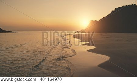 Slow motion sunset seascape at mountain island aerial. Tropic nobody nature landscape at summer sun set light evening. Ocean waves at sand beach. Cinematic El Nido Island, Philippines, Asia