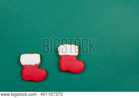 Santa Claus Boots On A Green Background. Christmas Gingerbread Boots