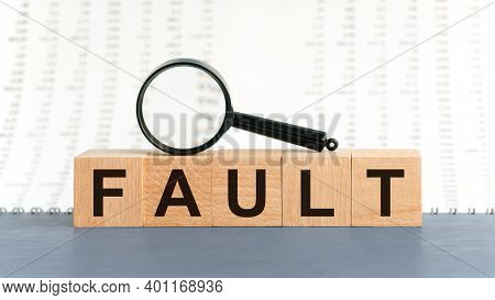 Wooden Blocks With The Text: Fault. Fault Word Made With Building Blocks, Business Concept