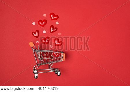 Flatlay Above Close Up View Photo Of Empty Pushcart With Red Decorative Hearts Isolated Bright Backg