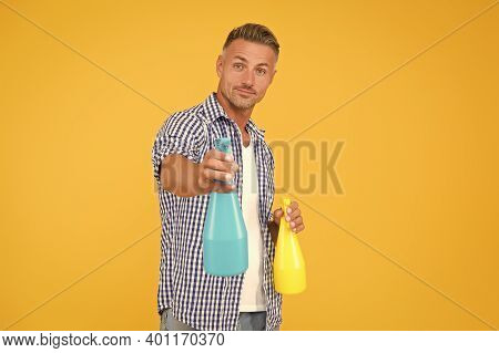Make Your House Clean. Handsome Guy Hold Spray Bottles. Disinfectant Cleaners And Sprays. Clean Habi