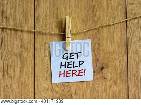 Get Help Here Symbol. Wooden Clothespin With White Sheet Of Paper. Words 'get Help Here'. Beautiful