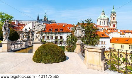 Prague Castle And St Nicholas Church In Lesser Town Of Prague. Sunny Spring Day View From Vrtba Gard