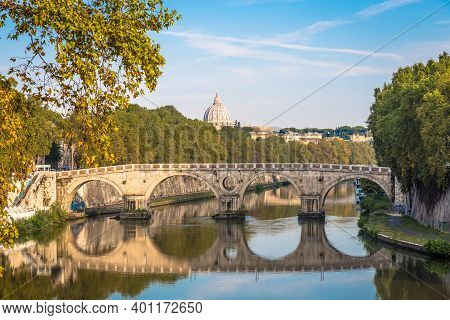 Rome, Italy - Circa August 2020: Bridge On Tiber River With Vatican Basilica Cupola In Background An