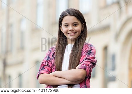 Stylish And Confident. Confident Kid Keep Arms Crossed Outdoors. Fashion Look Of Cute Girl. Casual S
