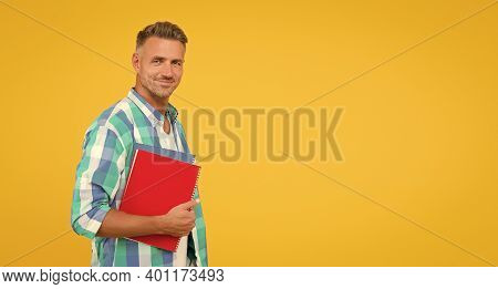 Man Adult Student. Final Exam And Graduation. Dedicated To Studying. Student With Textbooks. Regular