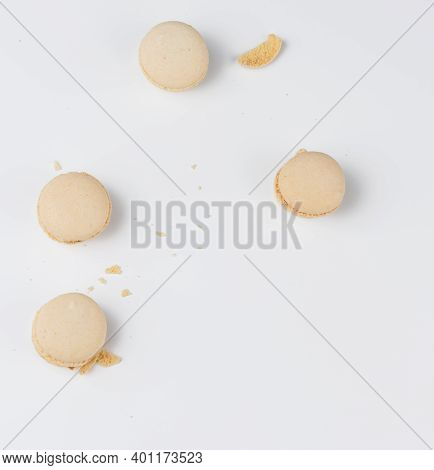Beige Baked Macarons Of Almond Anguish Broken Down On A White Background