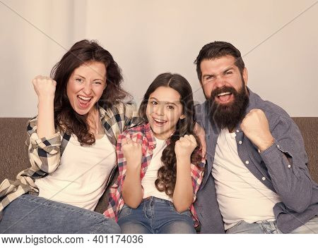 Together We Are Winners. Winners Celebrate Victory At Home. Happy Family Make Victory Gestures. Fami