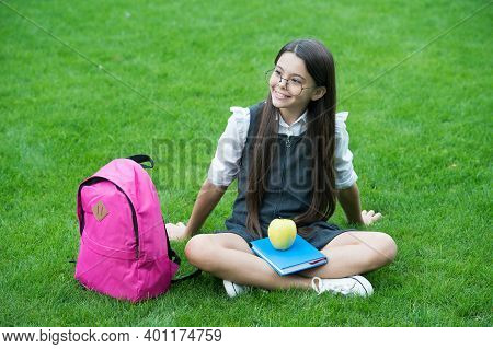Just What You Need To Feel Your Best. Happy Child Relax On Green Grass. School Snack. Snack Break. H