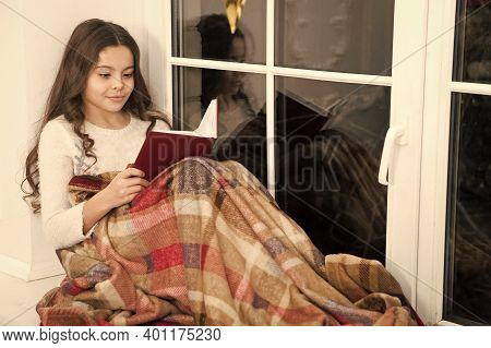 Carried Away Into World Of Fantasy. Small Girl Read Fantasy Book On Windowsill. Little Child Enjoy R