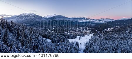 Aerial View Of Whistler Village And Ski Runs At Sunset.