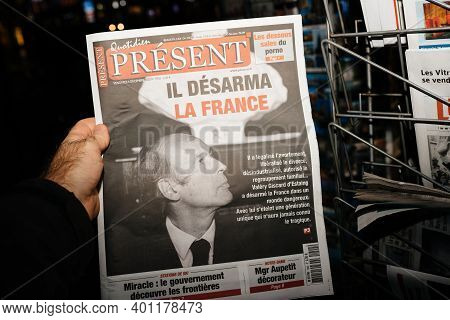 Strasbourg, France - Dec 4, 2020: Pov Male Hand Holding Quotidien Present Newspaper At French Press