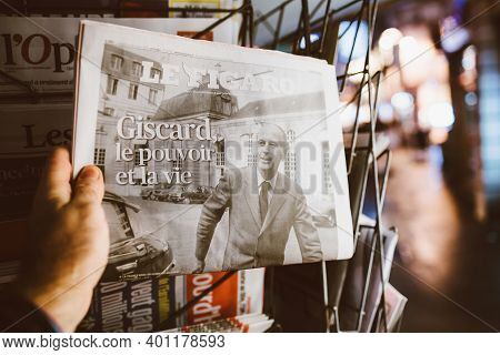 Strasbourg, France - Dec 4, 2020: Man Holding Le Figaro Newspaper At French Press Kiosk Announcing T