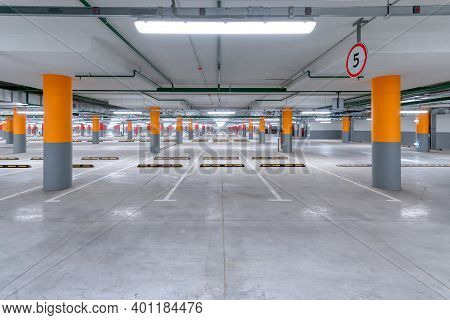 Large Underground Parking For Cars. Empty New Parking Lot With Cement Floor.