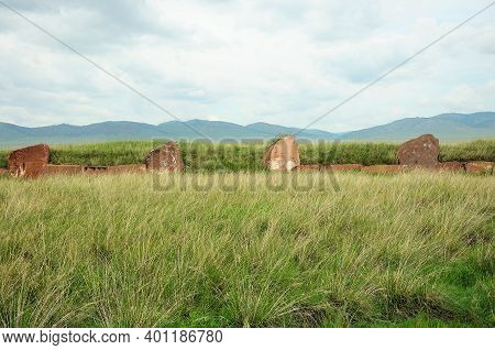 Remains Of An Ancient Burial Site, Large Stone Walls In The Steppe.