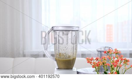 Close-up Of Healthy Green Smoothie, Detox Cocktail Preparing In Blender.