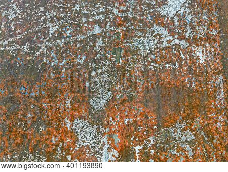 Abstract Corroded And Tarnished Metal Surface. Grunge Texture Of Old Rusty Metal With Remnants Of Ol