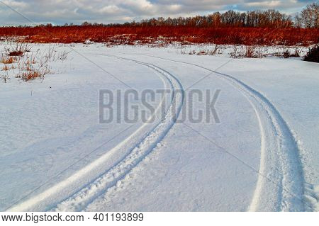 A Track Of Car Tires On An Empty Winter Country Road, Winter Landscape