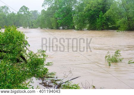 The River Overflowed Its Banks After Prolonged Heavy Rains, An Environmental Problem, A Natural Phen