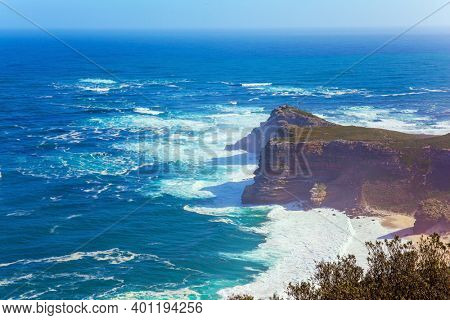 Bird's-eye view. Cape of Good Hope at the southern tip of the Cape Peninsula, South Africa. Powerful ocean surf. Bright sunny summer february day