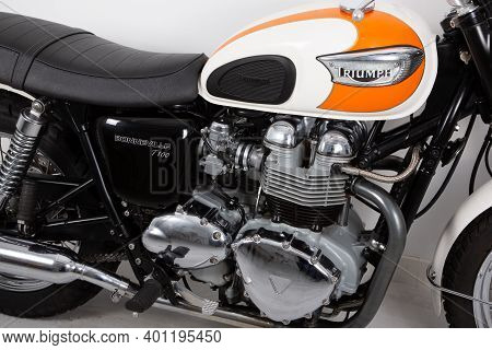 Bordeaux , Aquitaine  France - 12 25 2020 : Triumph Bonneville T100 White Orange Tank Carburetor Vin