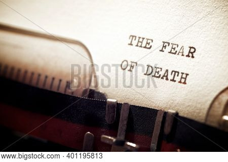 The fear of death phrase written with a typewriter.