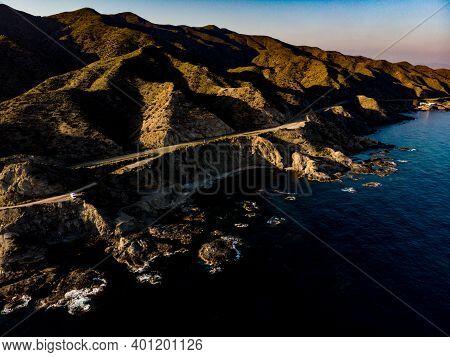 Aerial View. Road Along Spanish Rocky Shoreline. Mediterranean Region Of Villaricos, Almeria, Easter