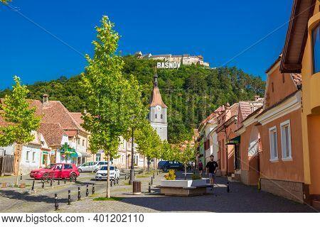 Rasnov, Romania - August, 2019: Streetlife In Rasnov In Sunny Summer Day. On The Street Of A Medieva