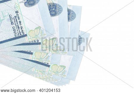 50 Sri Lankan Rupees Bills Lies In Small Bunch Or Pack Isolated On White. Mockup With Copy Space. Bu