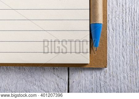 A Clean, Blank Lined Notebook And A Pen. A Place To Write Down Your Notes.