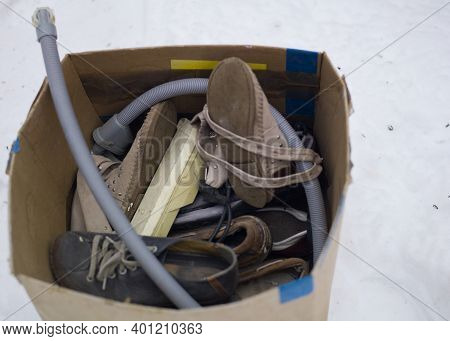 Cardboard Box Full Of Used Footwear And Household Goods