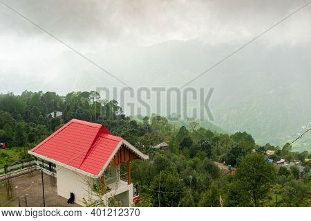 Red Roofed House Residence Hotel Homestay Lodge Looking Over A Cloudy Fog Filled Valley With Trees F