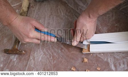 Sawing Out A Section Of The Door Frame When Fitting The Desired Size During The Installation Of Room