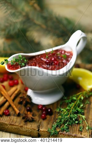 Selective Focus. Homemade Cranberry Sauce In A Gravy Boat. A Note With The Inscription Cranberry Sau