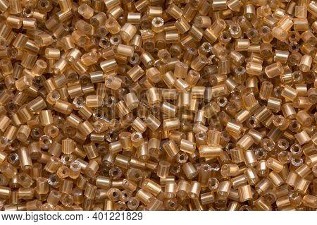 Background Texture Of Gold Beads Closeup. Seamless Beads Texture. Hobbies, Handmade Jewelry, Craft.
